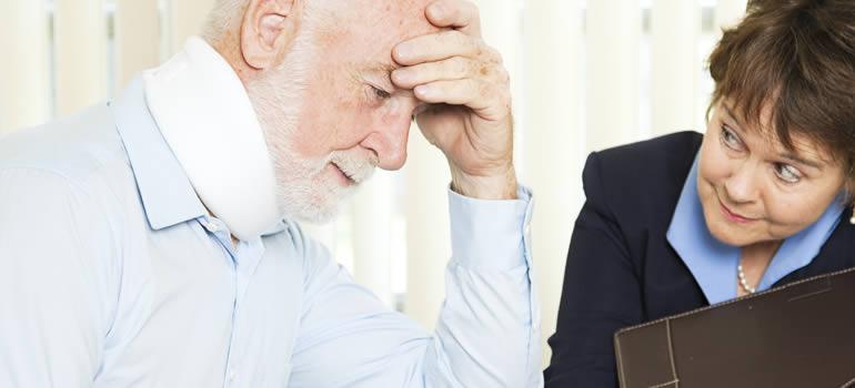 man-in-neckbrace-talking-to-attorney